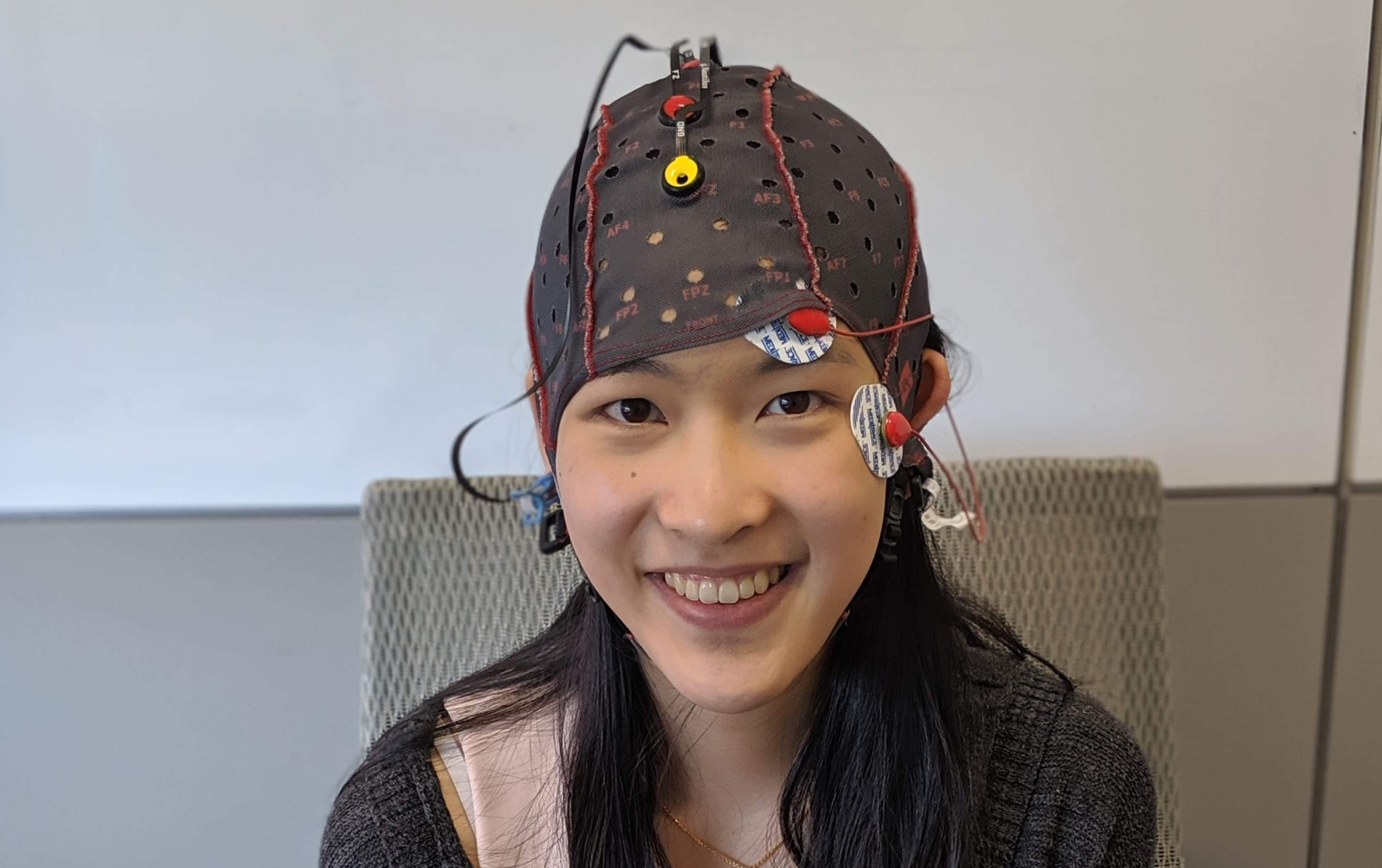 scientist helping patient with an eeg cap